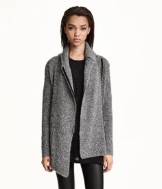Knitted cardigan in wool-blend bouclé yarn with a shawl collar, long sleeves and a zip at the side.