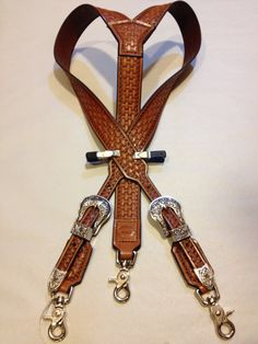 Hand tooled leather suspenders.