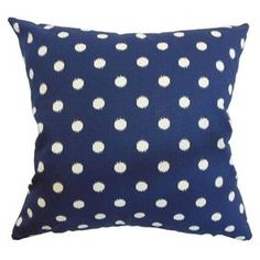 """Add a pop of style to your sofa, arm chair, or settee with this lovely cotton pillow, showcasing an ikat dots motif in a navy palette. Made in the USA.   Product: PillowConstruction Material: Cotton and down featherColor: Navy and whiteFeatures:  Insert includedHidden zipper closureMade in the USA Dimensions: 18"""" x 18""""Cleaning and Care: Spot clean"""