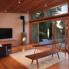 Modern poolside retreat finished with natural western red cedar flooring and ceiling | Flavin Architects