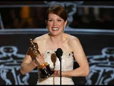 """Julianne Moore Winning Best Actress --- Matthew McConaughey presenting Julianne Moore with the Oscar® for Best Actress for her performance in """"Still Alice"""" at the Oscars® in Julianne Moore, Oscars, Jk Simmons, Still Alice, Best Actress Oscar, Grand Budapest Hotel, Best Supporting Actor, Oscar Winners, Fotografia"""