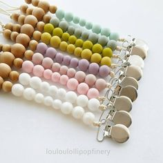 Our pacifier clips are constructed in colorful silicone and maple wood beads. They are perfect for babies on the go. Keep your babya