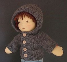 Love the boy doll and the sweater!