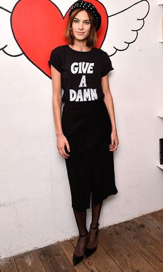 Alexa Chung in a black slogan tee and skirt with studded beret