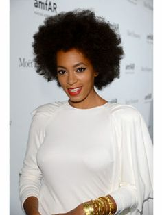 Solange's new afro style is effortlessly chic. To achieve this look, start by prepping the hair with a double strand twist. Use a moisturizing and texturizing cream to help set the pattern—try Motions Hydrate My Curls Pudding; it's great for natural textures!    Once dry, use a pick to loosen the twist out and create your desired shape. Once achieved, set the look with a shine enhancing spray such as the Motions Oil Sheen & Conditioning Spray, which will keep your locks hydrated.