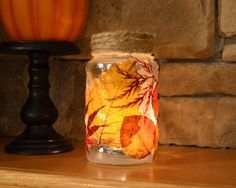 Using Mod Podge, fall leaves can be decoupaged on to a recycled glass jar. When you place a votive candle inside, the light shines through the leaves, creating a beautiful effect.