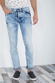 Calças de ganga corte slim estilo deslavado<BR>Azul claro