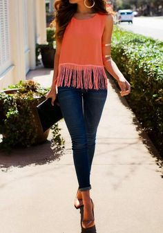 Full length of model in Orange Flowy Fringe Tank