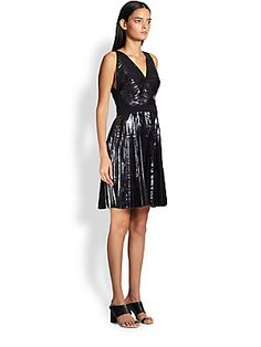 """Proenza Schouler Pleated Foil Dress Shimmering pleats of metallic foil fabric are tailored into a ladylike design, framed by an elegant surplice neckline.  Allover pleating Surplice neckline Sleeveless Banded waist Flared skirt Contrast back panel Concealed side zipper About 32"""" from shoulder to hem Polyester Dry clean Made in Italy Model shown is 5'11"""" (180cm) wearing US size 4."""