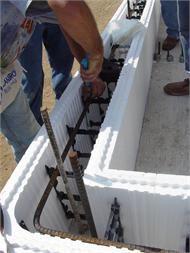 Insulating Concrete Form (ICF) blocks tied to vertical and horizontal rebar. www.bontool.com