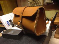 Handmade bicycle bag , nice leather hand stitched will work nice behind the seat or on the handle bars 10 x 5 x 3