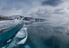 So many beautiful pictures on this site and don't forget page 2. They went skating over the ice of lake Baikal in the Russian region of Siberia. It's the deepest and oldest (25 million years) lake in the world. It took them less than 2 weeks to overcome 400 km on skates. Original source (Russian) in 3 parts here: http://satorifoto.livejournal.com/tag/Байкал