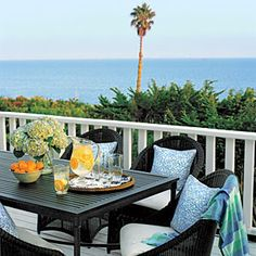 All-weather wicker with chair pillows that reflect the color of the ocean are excellent choices for your oceanfront home (or condo).  Reflect the Sea   CoastalLiving.com