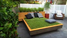 If your garden grass is not enough, or you really love the comfort of a cozy bed, you can make your own outdoor grass daybed as demonstrated here.