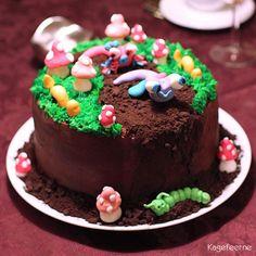 Jordbunds kage med snegle, orme og paddehatte