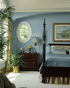 A classic blue bedroom with classic dark furniture, a damask coverlet & taupe silk bedskirt. But the curved soffit above the bed & the oval window kicks things up a notch. Bam! You have a tasty treat of a room.....V