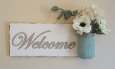 A personal favorite from my Etsy shop https://www.etsy.com/listing/226012212/mason-jar-welcome-wood-wall-hanging-hand