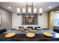 this cozy dining room, with blue modern chairs, colorful runner, and built-ins is featured on our new website: down2earthdesign.com