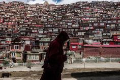 A Buddhist nun with a prayer wheel in Larung Gar, a monastic camp where thousands of nuns and monks live and study, in Sichuan Province, China. But now, they're being forced out of the area. http://nyti.ms/2fIyBON  Photo: Gilles Sabrié for The New York Times