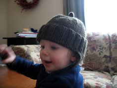 I created this pattern when I couldn't find a hat pattern I liked for my one-year-old son. I didn't have the time to keep searching the internet for the perfect pattern, so instead I created my own. I apologize for the dodgy photos—my model wasn't quite cooperating. I'll post better ones soon.