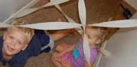 Make an obstacle coarse with crape paper streamers. I used our hallway. They crawl and step over all of it while trying not to touch the streamers.