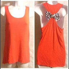 Corral Crush hi low racer back size Medium Corral Crush  hi low racer back tank, chevron bow in back adds a very chic look. Medium Charming Charlie Tops