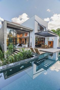 I love open spaces, contemporary, lots of windows, and a view of water and/or pool.