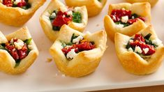 Spinach, Artichoke and Feta Bites Recipe: Need a fun vegetarian app for your party platters? Look no further--these creamy, cheesy treats are sure to please veggie-lovers and meat-eaters alike. Christmas Appetizers, Appetizers For Party, Appetizer Recipes, Spinach Appetizers, Dinner Recipes, Breakfast Recipes, Christmas Party Food, Christmas Recipes, Christmas Potluck