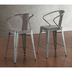The sturdy steel construction makes these functional Tabouret bar stools an ideal choice for any home. A durable powder-coated finish on these stools leaves them mar and scratch resistant.