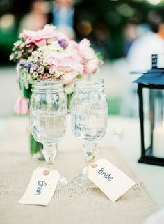 gorgeous bride and groom placing -mason jars/goblet style