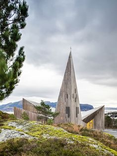 The church, located on the scenic west-coast of Norway north of Bergen, is built on a privileged site overlooking the cultural landscape and local town centre.