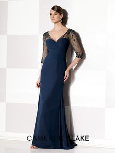 Cameron Blake - 215630 - Chiffon slim A-line gown with hand-beaded illusion three-quarter sleeves and V-neckline, surplus pleated sweetheart bodice, beaded illusion keyhole back, inset sweep train.Sizes: 4 – 20, 16W – 26WColors: Navy Blue, Champagne, Dark Heather