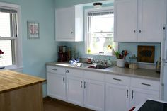blue kitchen wall color, white cabinets