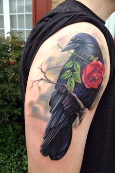 Tattoo of a Raven carrying a rose. For more stunning and wonderful tattoo ideas and design, visit www.tattooenigma.com