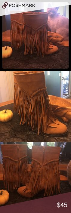 Just in time for fall! Fringe Boots! 8.5 AXNY Just in time for fall! Super cute, clean, & fun! 8.5 tan, w/ 3 inch heel fringe/tassel boots! I wore these 2 or 3 times. Love them, but I have a back injury & cant wear high heels now 😪. My loss. These are in great shape. Cat not included. 🤣 axny Shoes Heeled Boots