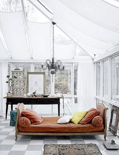 White w/ a random pop of color. Love the shape of that daybed...