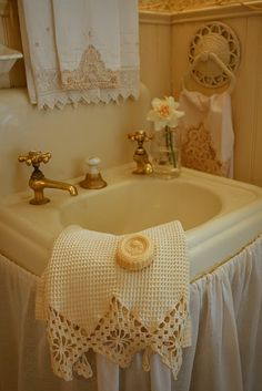 The vintage linens make this simple bathroom.