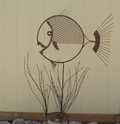 rusty fish made from junk metal...would also look good in pond or pool area.