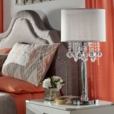 Add some flair and elegance to your home with this chrome-finished crystal table lamp from Silver Mist. This lovely lamp's faux-silk shade combined with dangling crystal ornaments and polished chrome creates a sophisticated ambiance for any room.