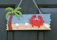 Great summer project when it's too hot to go outside, so cute! Beach door hanger craft.