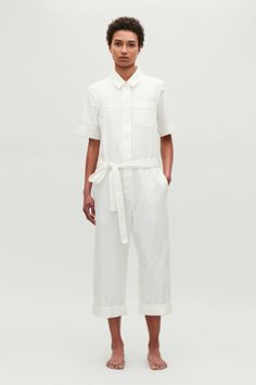Model front image of Cos belted cotton jumpsuit in neutral Cotton Jumpsuit, Lace Jumpsuit, White Jumpsuit, Black Romper Shorts, Romper Suit, Shirt Dress, Long Jumpsuits, Jumpsuits For Women, White Fashion