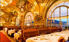 This magnificent restaurant in Paris should be saved for a special occasion. Luxuriously decorated in an Opera Garnier style , Le Train Bleu (blue train) is a gourmet French Brasserie that serves traditional French cuisine in a historical location inside the Gare de Lyon.