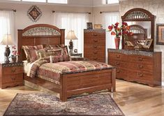 "Enhance your bedroom decor's beauty with the traditional style of the ""Fairbrooks Estate"" bedroom collection."
