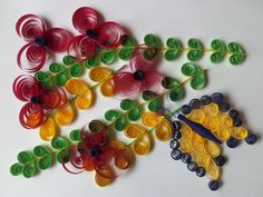 Quilling, A Quilled Butterfly and Flowers Scene  http://www.quilling.in/quilled-flower-and-butterfly-design/