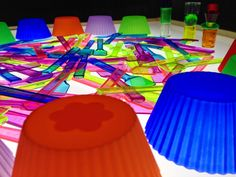 gelato spoons, giant lacing beads, and muffin cups on the light table