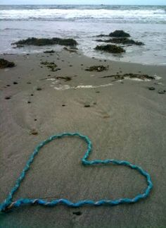 Rope heart on the beach.