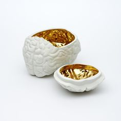 White and gold ceramic brain jar