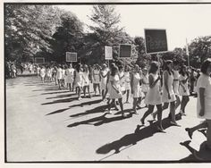 Mount Holyoke College Students in the Laurel parade with Peace Signs, 1970 :: Archives & Special Collections Digital Images