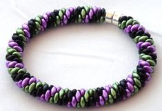 I made it ♥  SuperDuo Beaded Bracelet in Black Green and Purple by dlpdesigned. https://www.etsy.com/listing/178554437/superduo-beaded-bracelet-in-black-green?