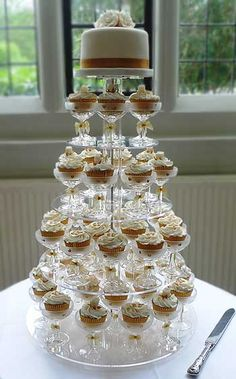 Cupcakes in champagne glasses.